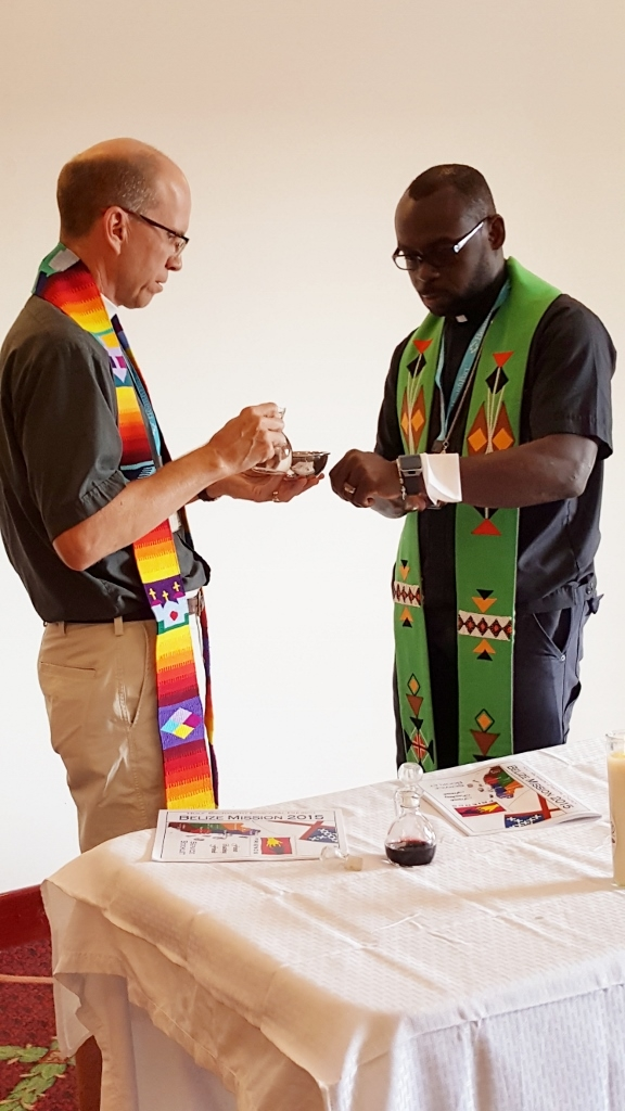 Fathers Jon Robbins and Tony Holder assisting each other during a morning Eucharist.