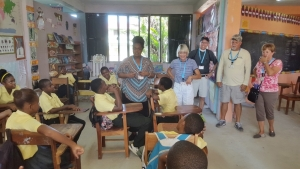 V.B.S. Leader, Dr. Dion Scotland, leading a Vacation Bible School class. Other missionaries are looking on.