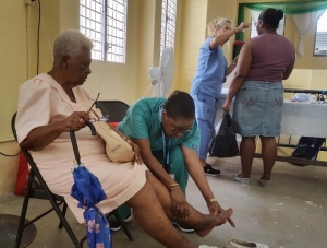 Dr. Arlene Richards, attending a patient at the Adult Health Clinic.
