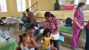 Dr. Patricia Rowe-King examining a child at the Pediatric Clinic.