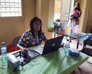 Debbie Stevens, recording pediatric  patient information.