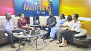 Armin Arana and Tarun Butcher interview Father Tony, Dr. Arlene Richards, Dr. Patricia Rowe-King, and Erna Cunningham at Love FM TV Belize.